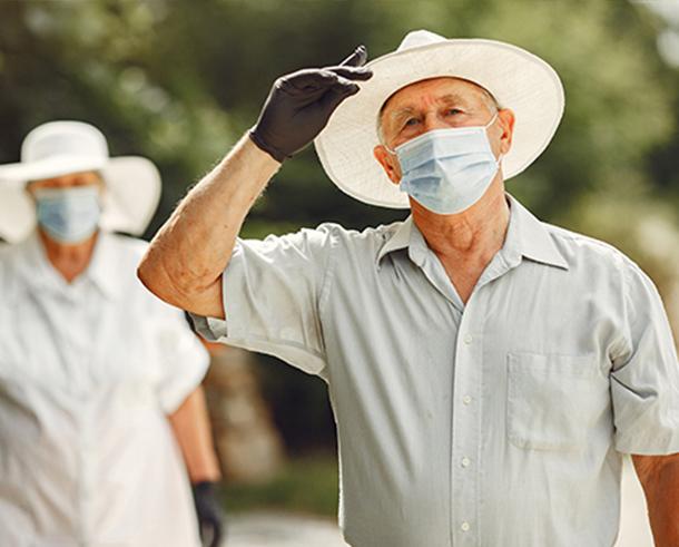 adult-couple-summer-garden-coromavirus-theme-people-medical-mask-handsome-senior-white-shirt